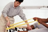 A female physiotherapist working on a man