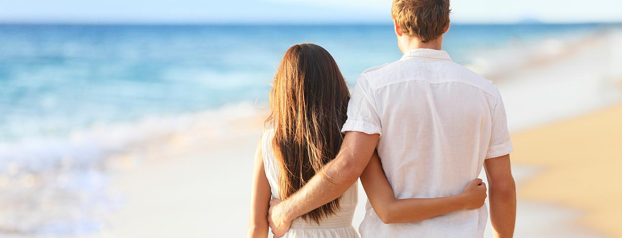 Couple walking on beach after marriage counseling