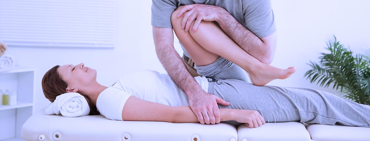 Woman worked on by chiropractor