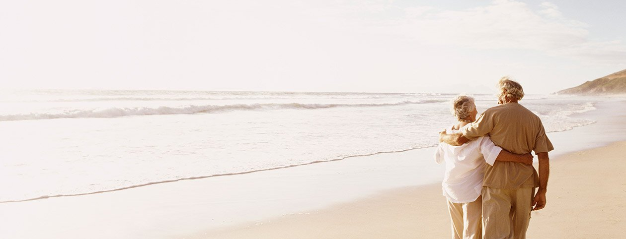 Couple walking on beach happily after christian marriage counseling