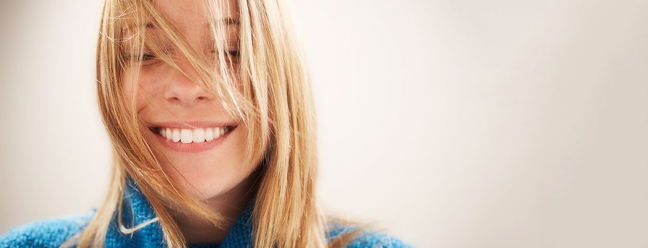 Happy woman with eyes closed avoiding depression