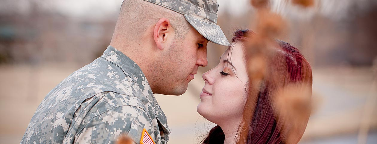 Wife hugging husband with PTSD