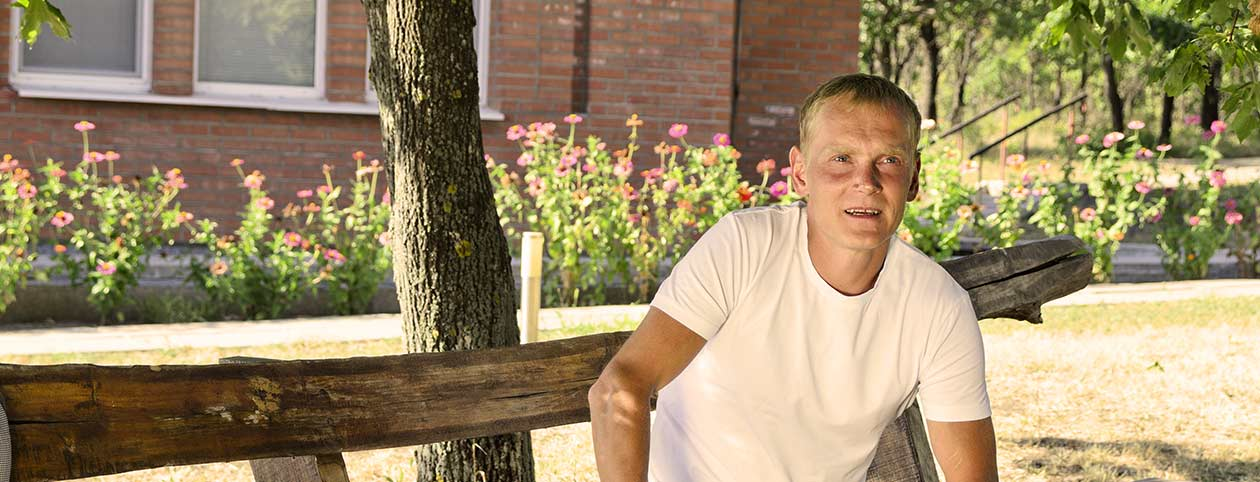 Man sitting on bench having a successful alcohol rehab