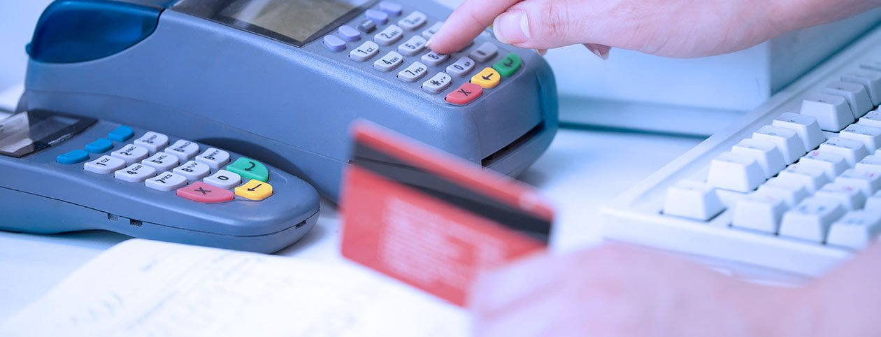 Woman paying for bariatric surgery with credit card