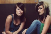 Two young women sitting, one has bipolar disorder