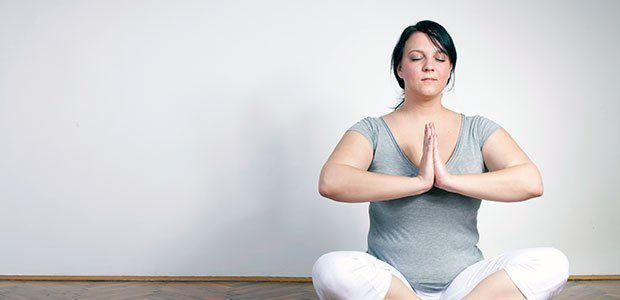 Woman practicing yoga methods at weight loss camp