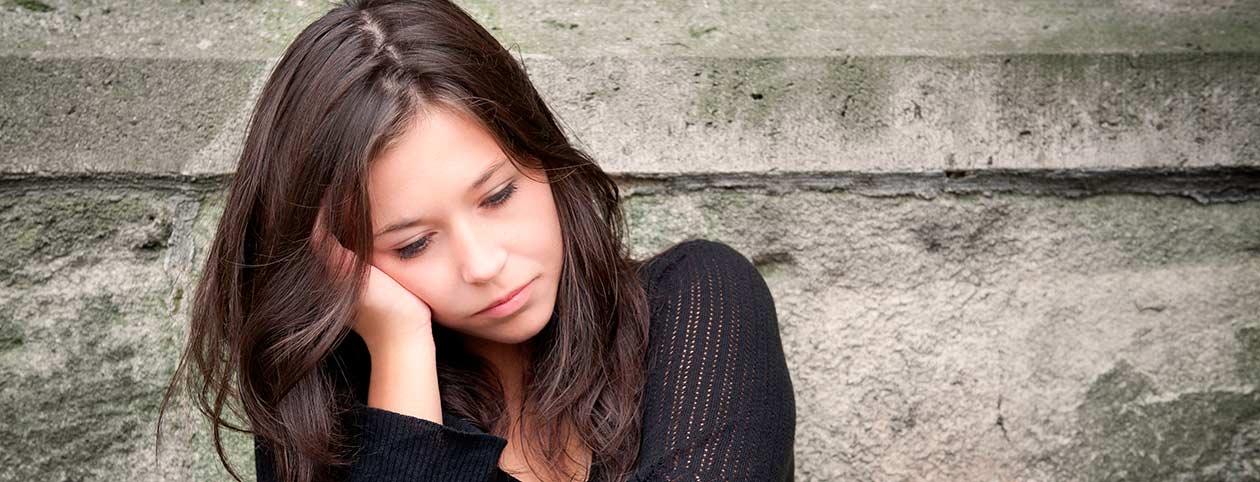 Woman sitting displaying symptoms of depression