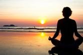 Woman practicing yoga at weight loss camp