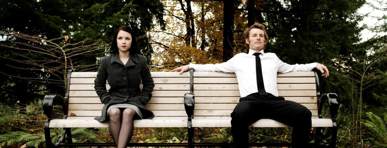 Couple sitting on bench marriage counseling