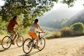 Couple Biking on a marriage retreat in california