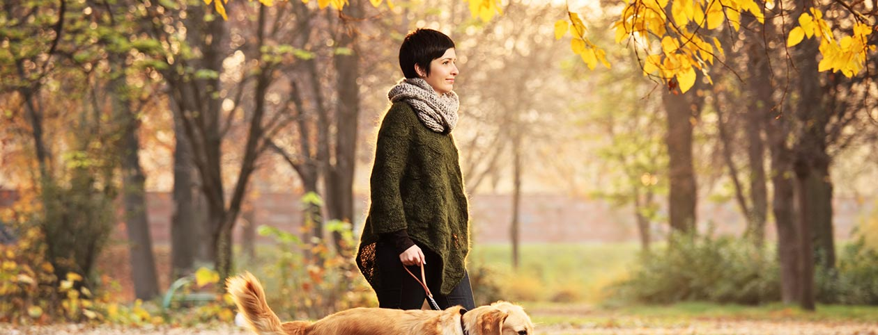 woman dealing with depression naturally walking dog