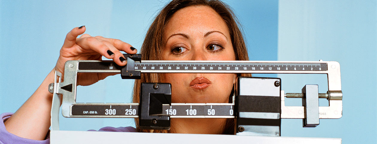 Woman Checking Scale