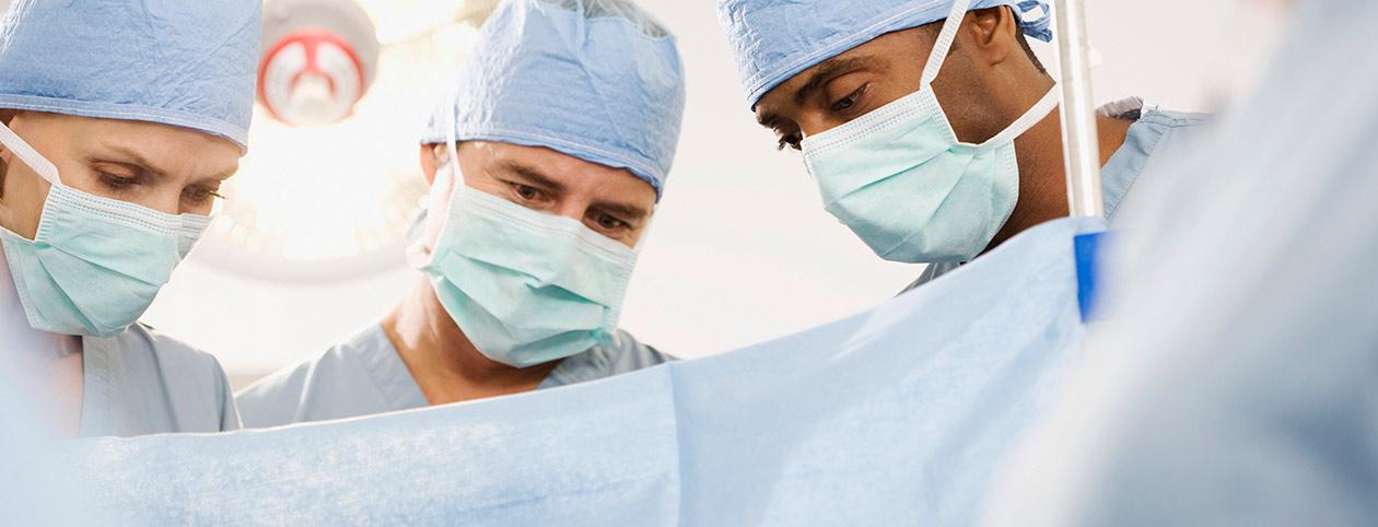 Surgeons performing vertical sleeve gastrectomy