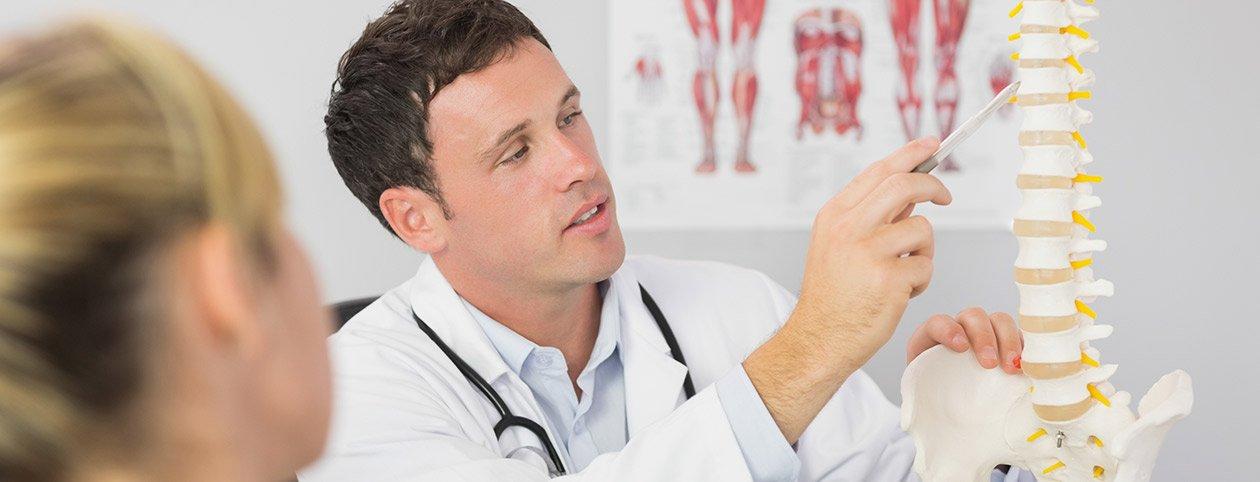 Chiropractor walking patient through popular chiropractic techniques
