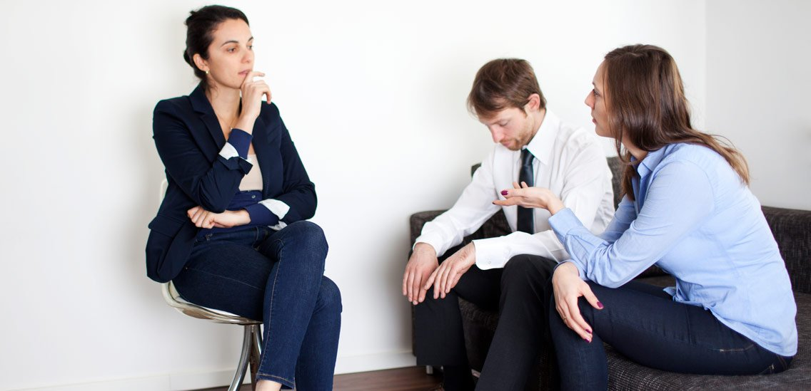 Couple in therapy session learning how marriage counseling works