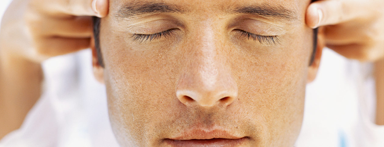 Man receiving alternative physical therapy for migraines