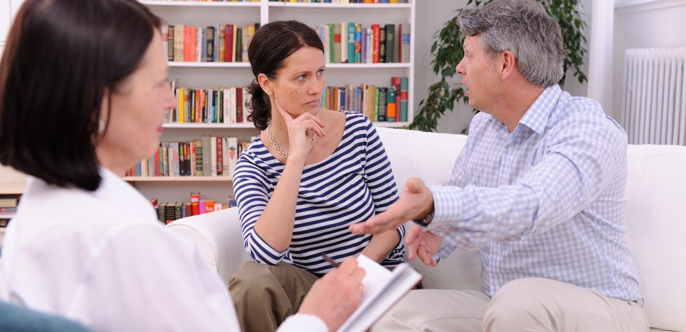 Married couple with their marriage and family counselor