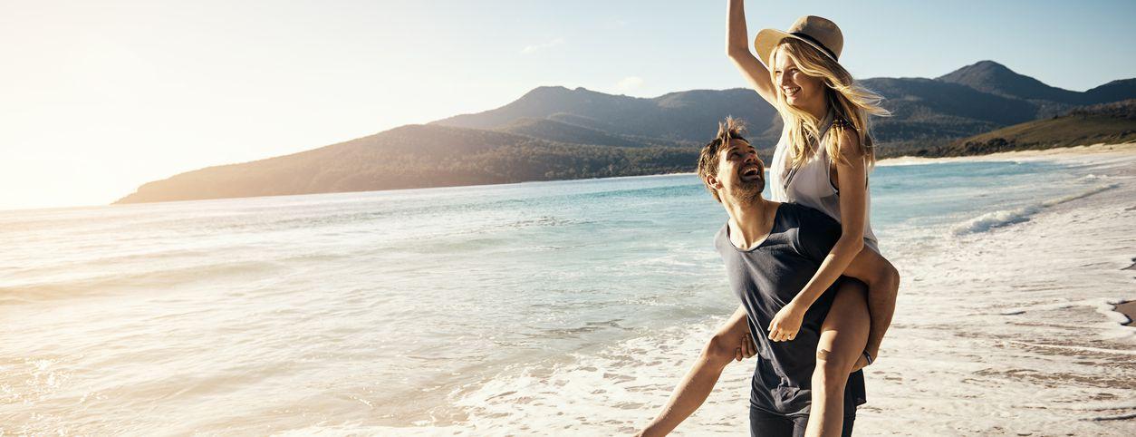 Couple enjoying marriage retreat on the beach