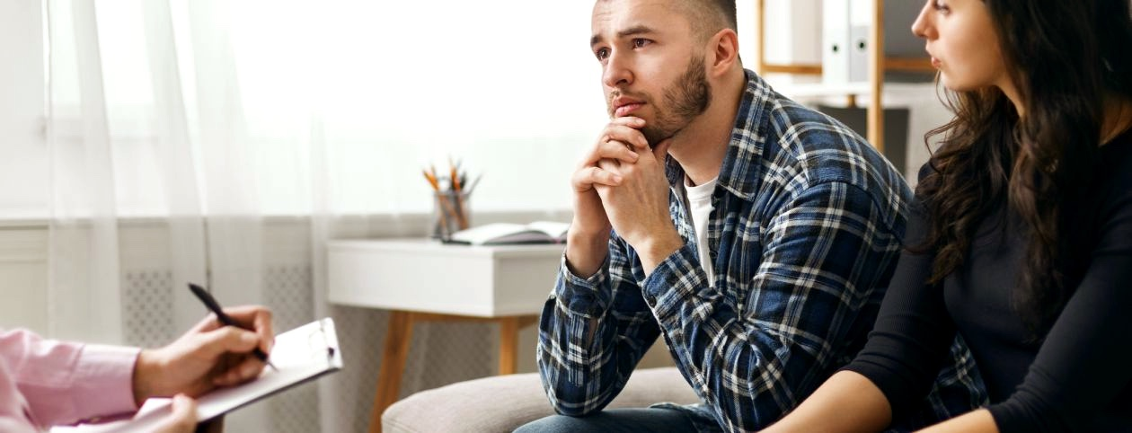 Psychologist giving marriage tips to newlyweds or premarital couple