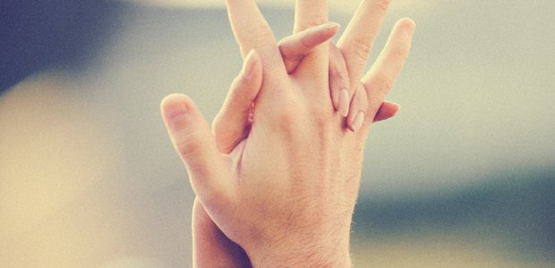 newlyweds-with-interlocked-hands